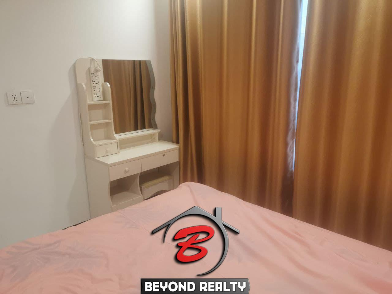 the bedroom of the 1-bedroom serviced condo for rent in Boeung Tompun Phnom Penh Cambodia