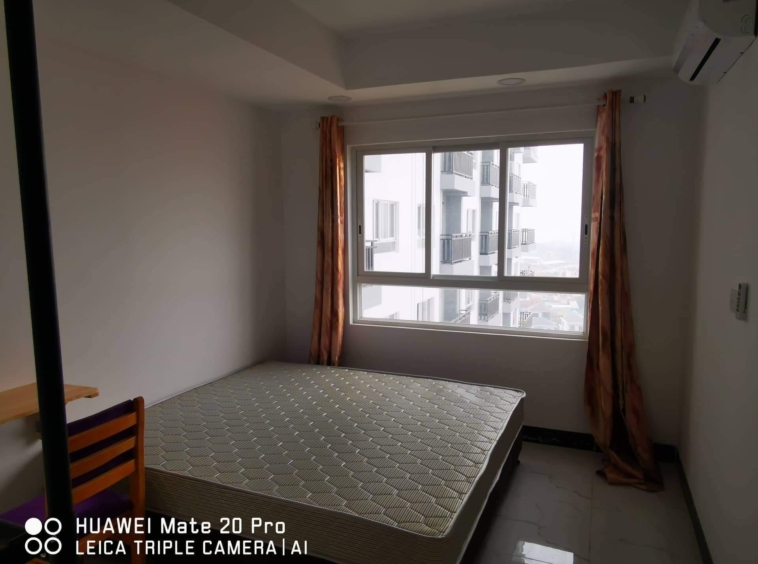 the bedroom of the 1br serviced condo for rent in Boeung Tompun Phnom Penh Cambodia