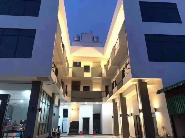 exterior of the apartment building for rent in Sihanoukville with artificial lighting - image watermarked