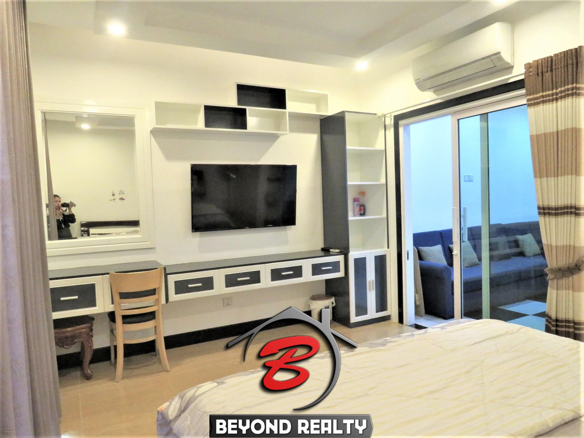 the living room of the well designed serviced condo for rent in TTP in Phnom Penh
