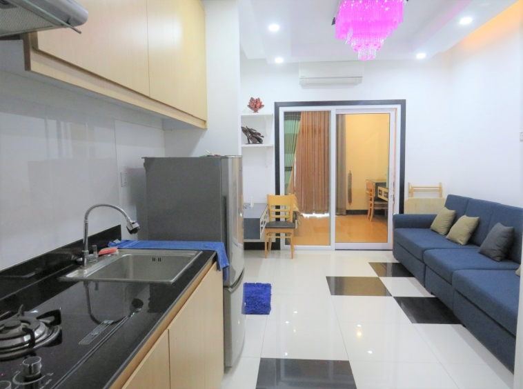 the living room and the kitchen of the well designed serviced condo for rent in TTP in Phnom Penh