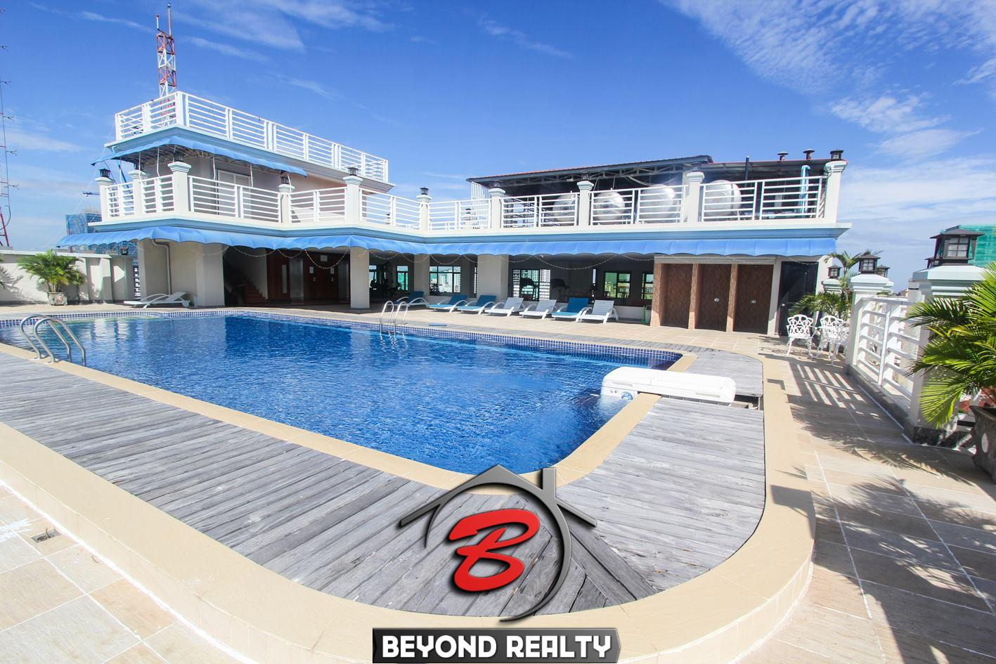 the swimming pool of the 1-bedroom luxury spacious serviced apartment for rent in BKK1 in Phnom Penh in Cambodia