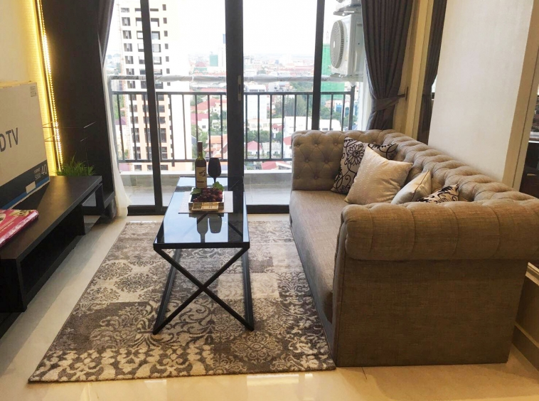 the living room of the luxury serviced 1-bedroom apartment for rent in BKK1 in Phnom Penh Cambodia