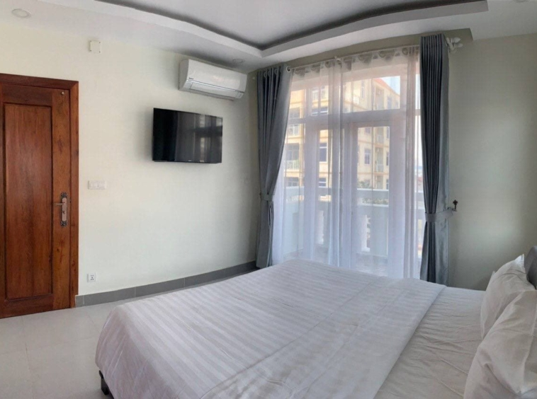 the bedroom of the 1br serviced apartment for rent in Boeung Trabek in Chamkar Mon Phnom Penh Cambodia