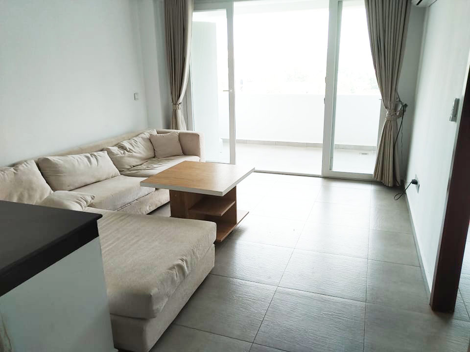 the living room of the 1-bedroom condo for rent in Sangkat 4 in Sihanoukville