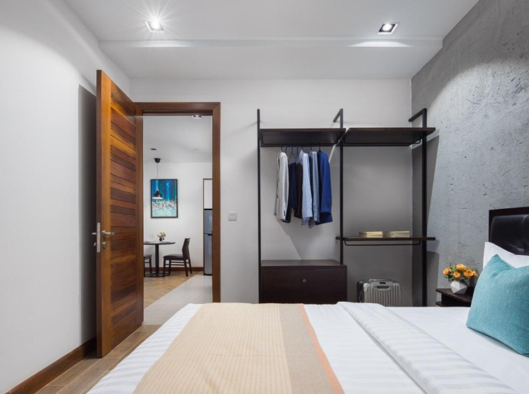 the bedroom of the 1br serviced apartment rental in Toul Tom Poung Phnom Penh Cambodia