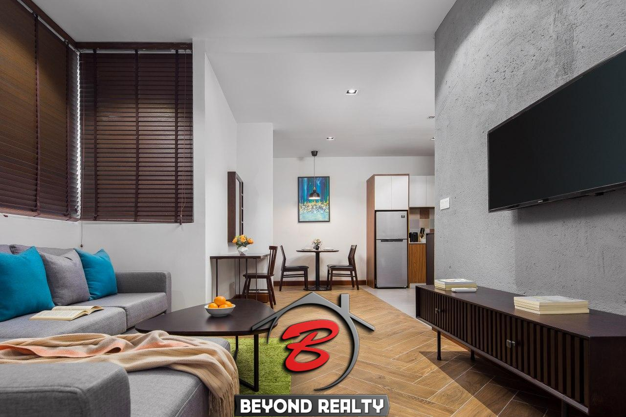 the living room of the 1br serviced apartment rental in Toul Tom Poung Phnom Penh Cambodia