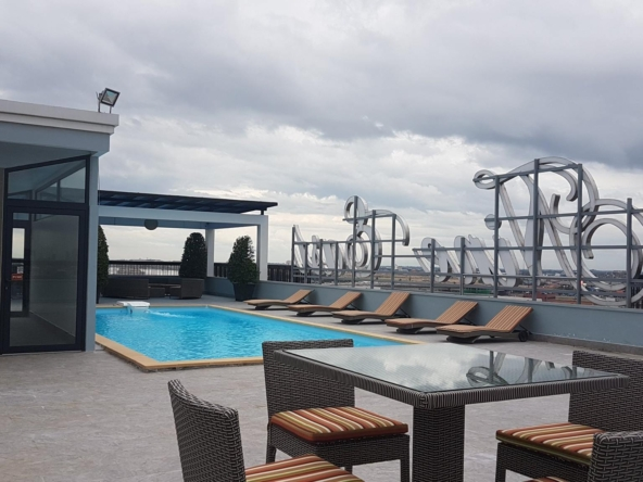 the swimming pool of the luxury serviced condo in Sangkat Srah Chak in Phnom Penh Cambodia