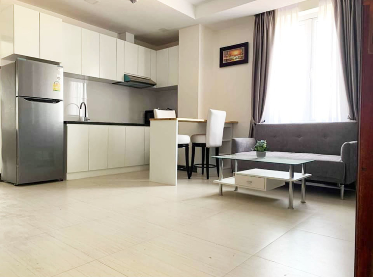 the living room and the kitchen of the 1-bedroom serviced apartment for rent in Toul Tom Poung in Phnom Penh