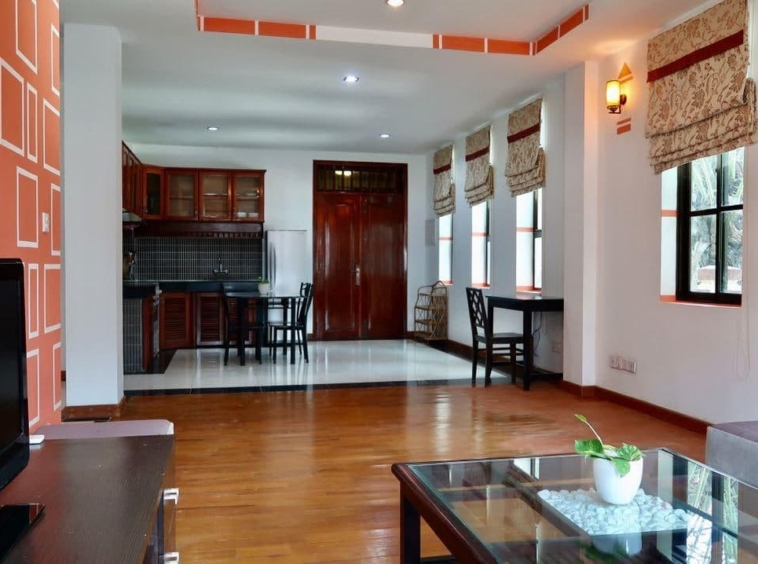 the living room and the kitchen of the 2-bedroom serviced apartment for rent near Wat Phnom in Daun penh in Phnom Penh Cambodia