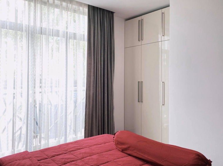 the bedroom part of the studio apartment unit in the luxury serviced condo in Sangkat Srah Chak in Phnom Penh Cambodia