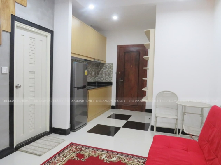 THE LIVING ROOM OF THE 1-bedroom condo for sale in Toul Tom Poung Russian Market Phnom Penh