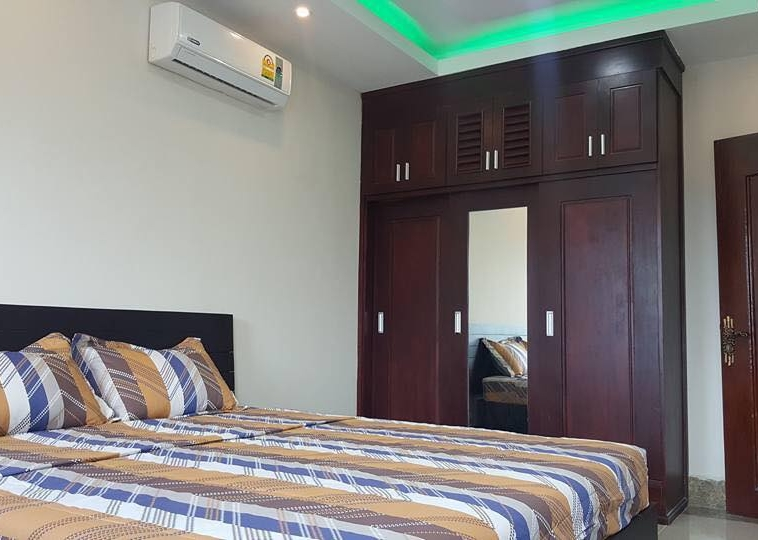 the bedroom of the 1br cozy serviced apartment for rent in BKK3 Phnom Penh Cambodia