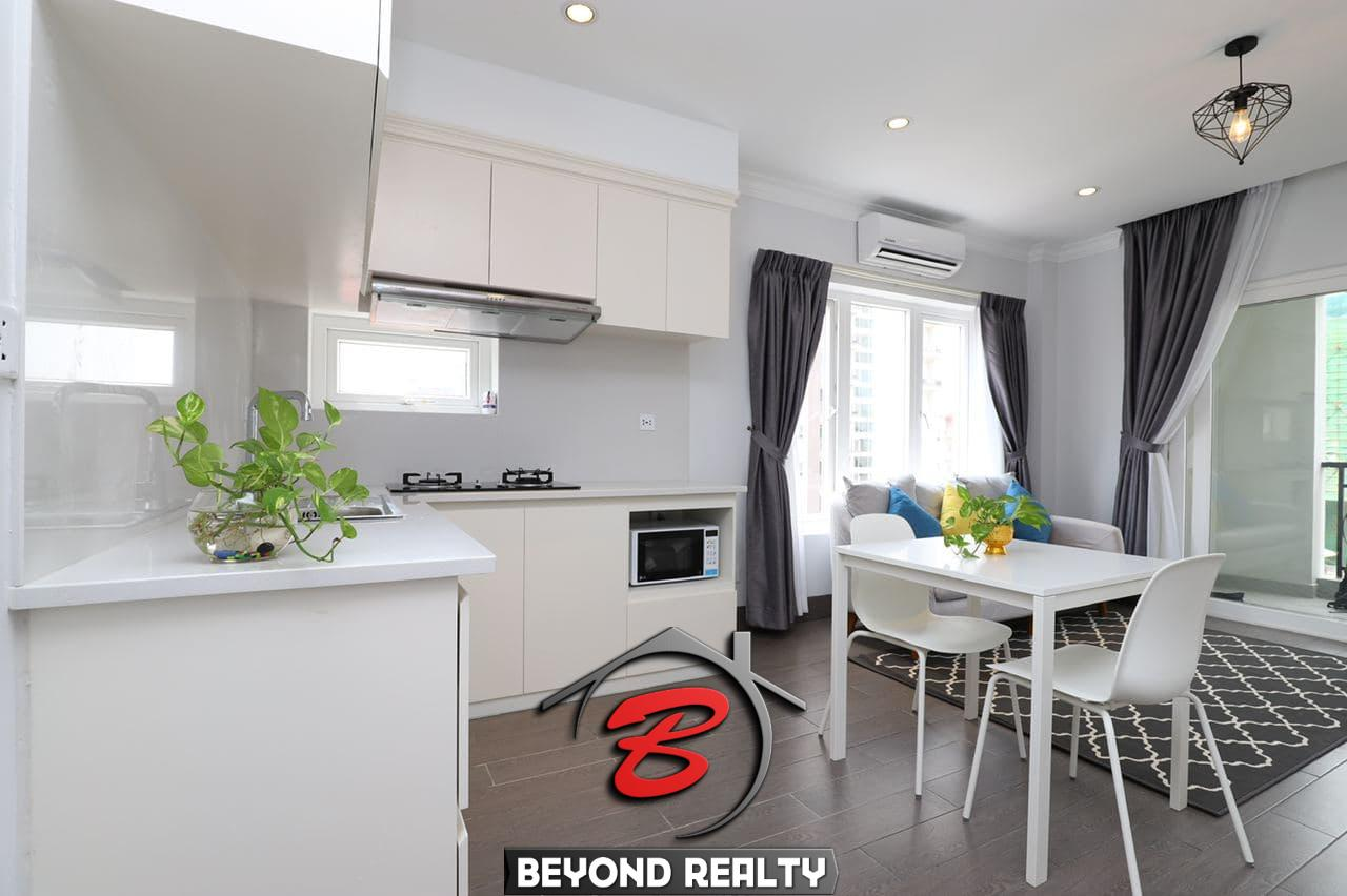 the kitchen and the living room of the 1br serviced apartment for rent in BKK1 Phnom Penh Cambodia