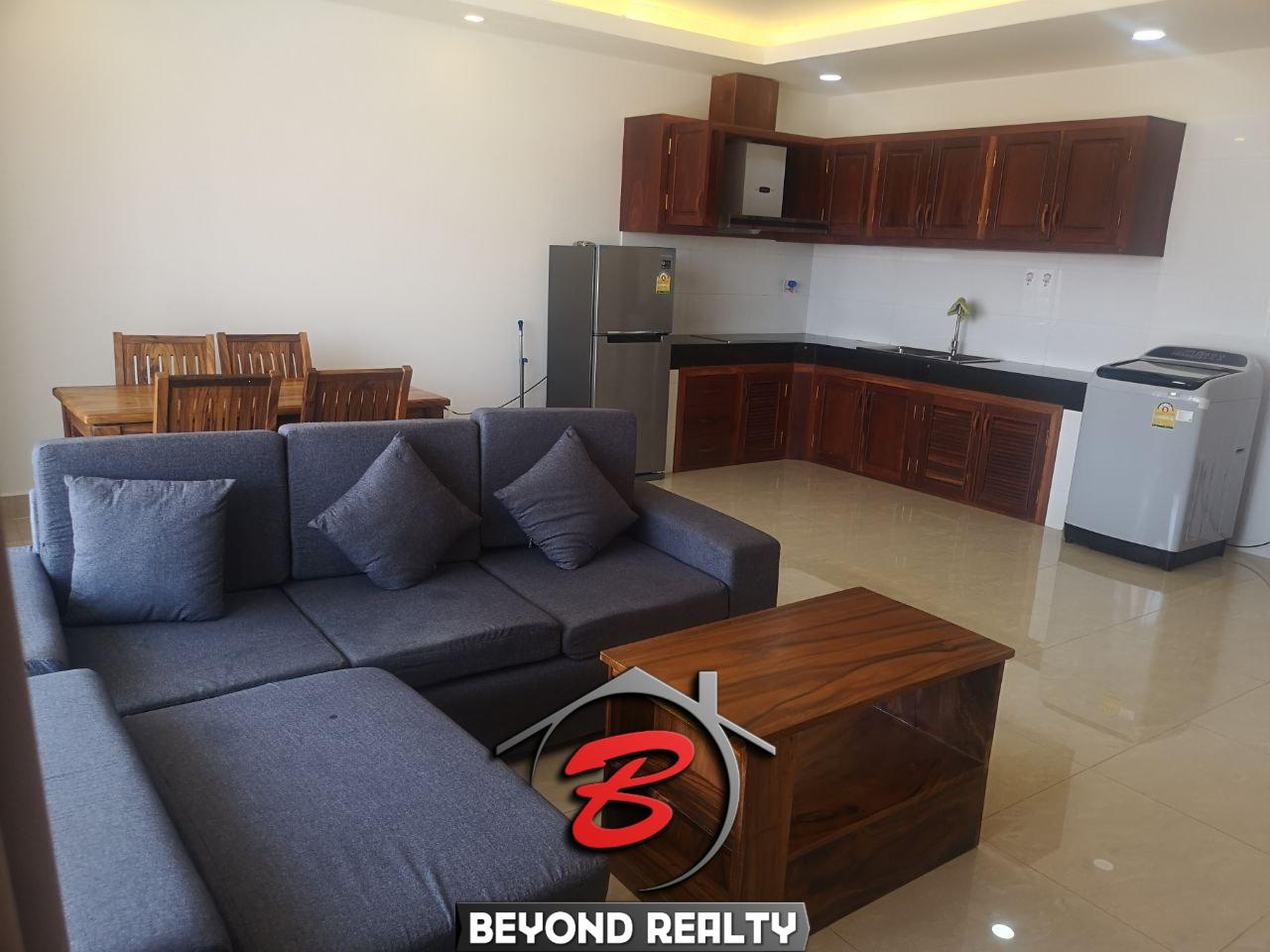 the living room and the kitchen of the 1br serviced apartment for rent in Toul Tom Poung Phnom Penh Cambodia