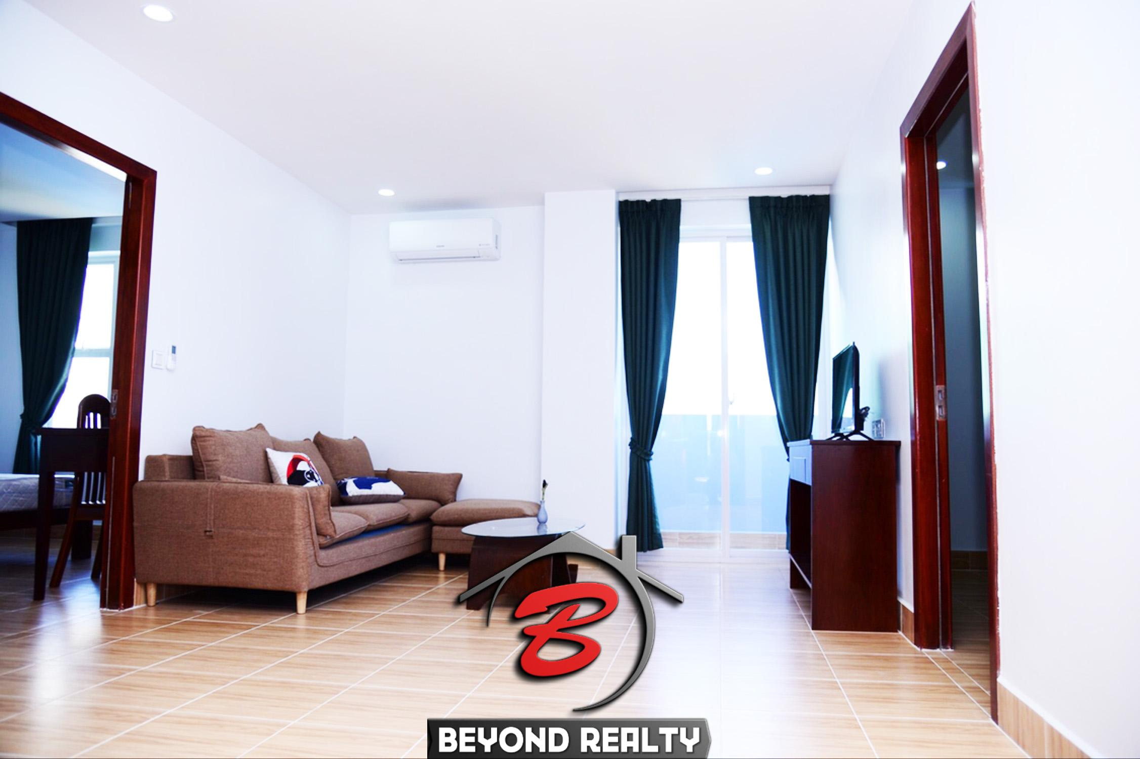 the living room of the 1br serviced apartment for rent in Toul Tom Poung near Mao Tse Boulevard in Phnom Penh Cambodia