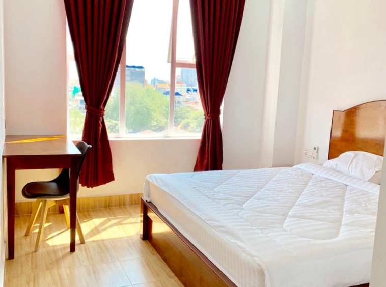 the bedroom of the 1br serviced apartment for rent in Toul Tom Poung near Mao Tse Boulevard in Phnom Penh Cambodia