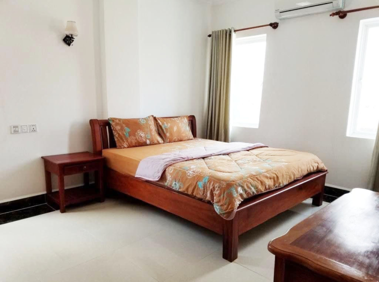 the bedroom of the 1br serviced flat for rent in Toul Tom Poung Phnom Penh Cambodia