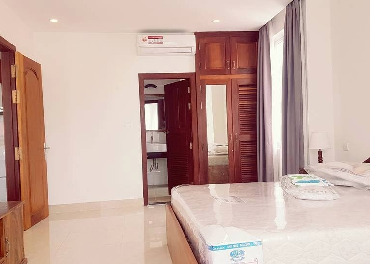 a bedroom of the 2-bedroom spacious serviced apartment rental in Toul Tom Poung