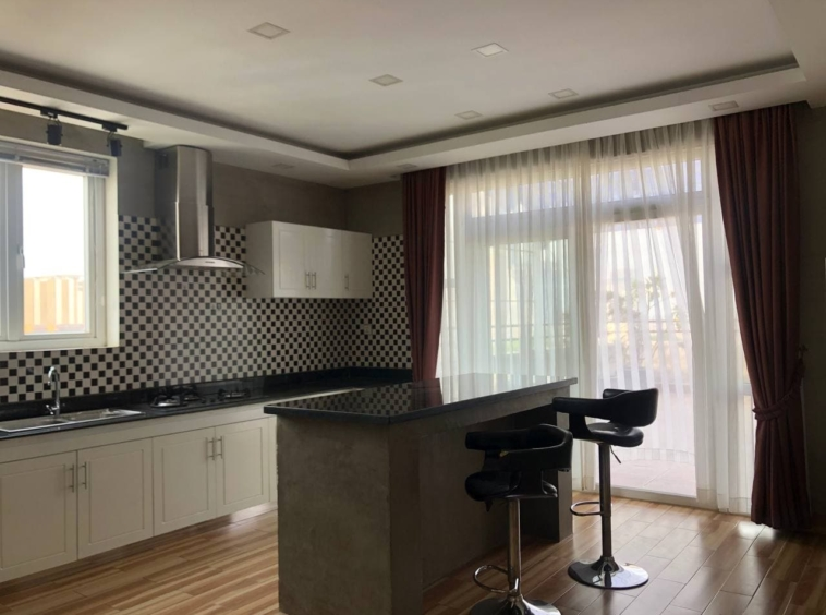 the kitchen of the 3-bedroom penthouse serviced apartment for rent in Tonle Bassac Phnom Penh Cambodia
