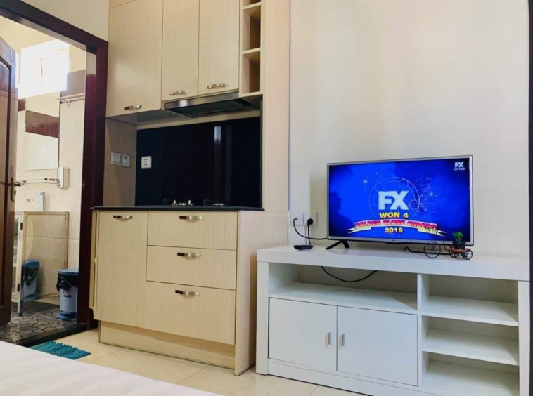 the tv and kitchen of the studio serviced apartment for rent in BKK2 in Phnom Penh Cambodia
