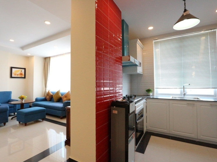 the kitchen and the living room of the 3-bedroom apartment for rent in BKK1 Phnom Penh Cambodia