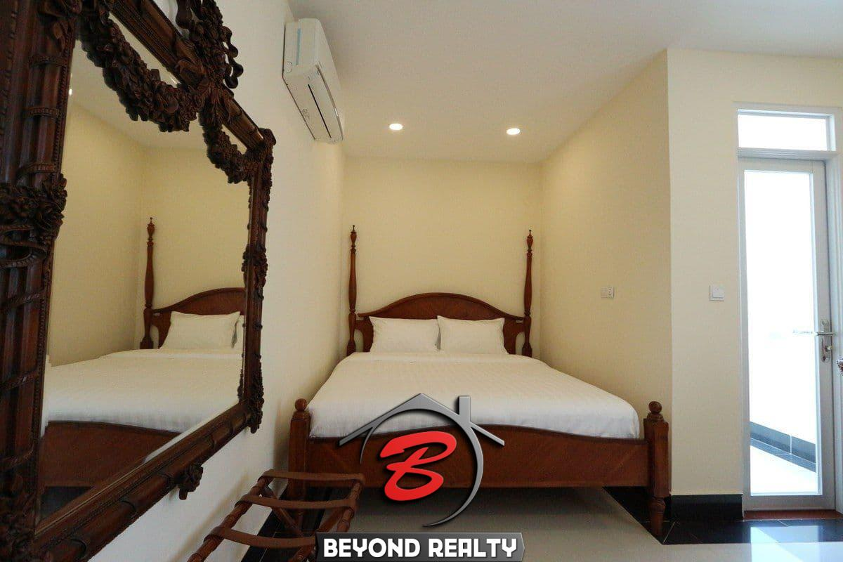 a bedroom of the 3-bedroom apartment for rent in BKK1 Phnom Penh Cambodia