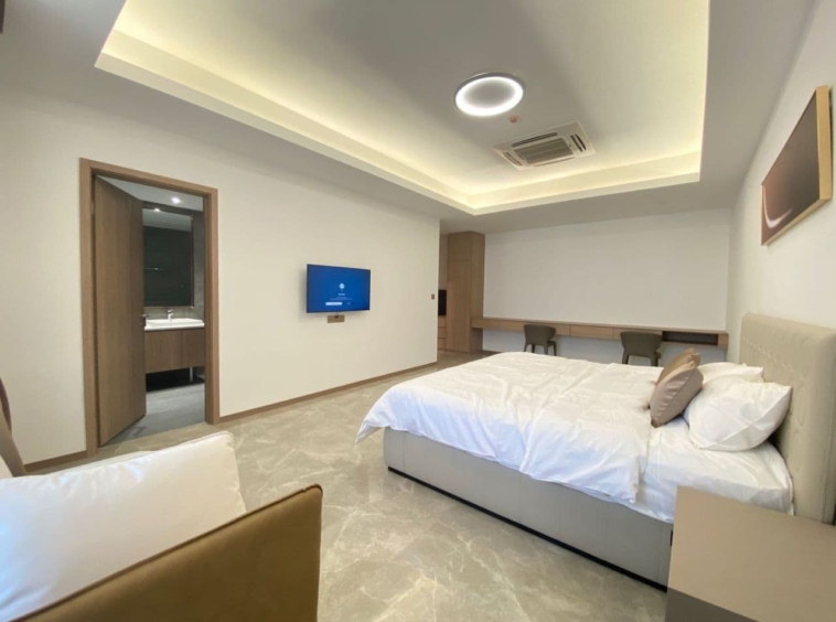 a bedroom of the 3-bedroom luxury spacious serviced flat for rent