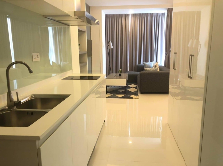 the kitchen and the living area of the studio apartment rental at st 63 in Tonle Bassac Phnom Penh