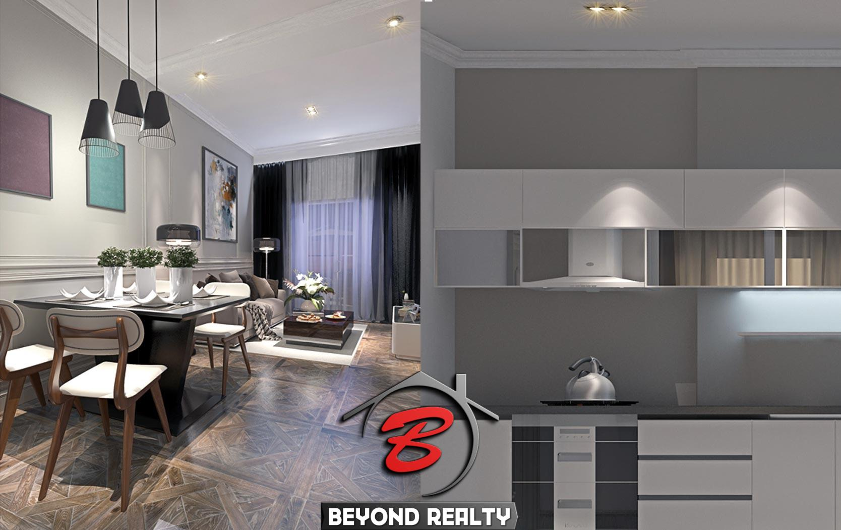 the kitchen and the living room of the 1 bedroom condo unit for sale at SeaGate Suite in Sangkat 3 Sihanoukville