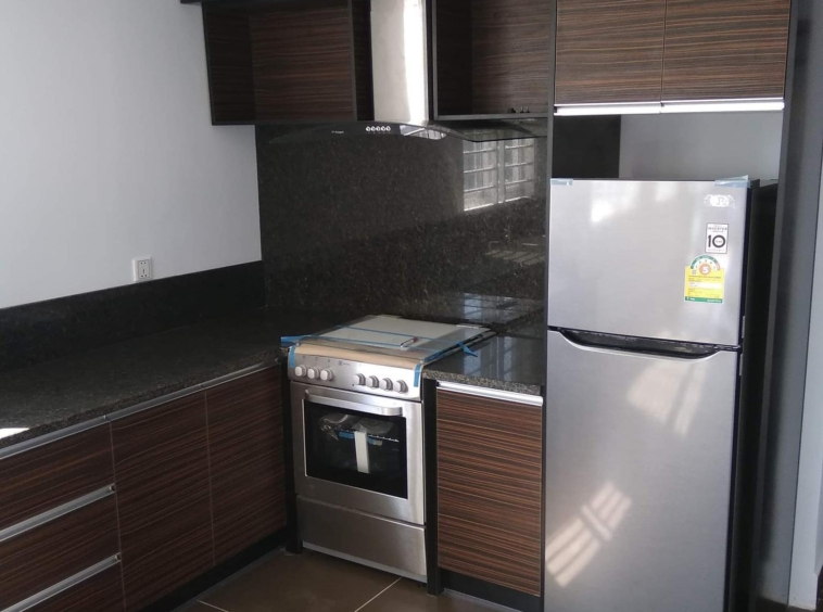 the kitchen of the 2br renovated apartment for sale riverside Phnom Penh