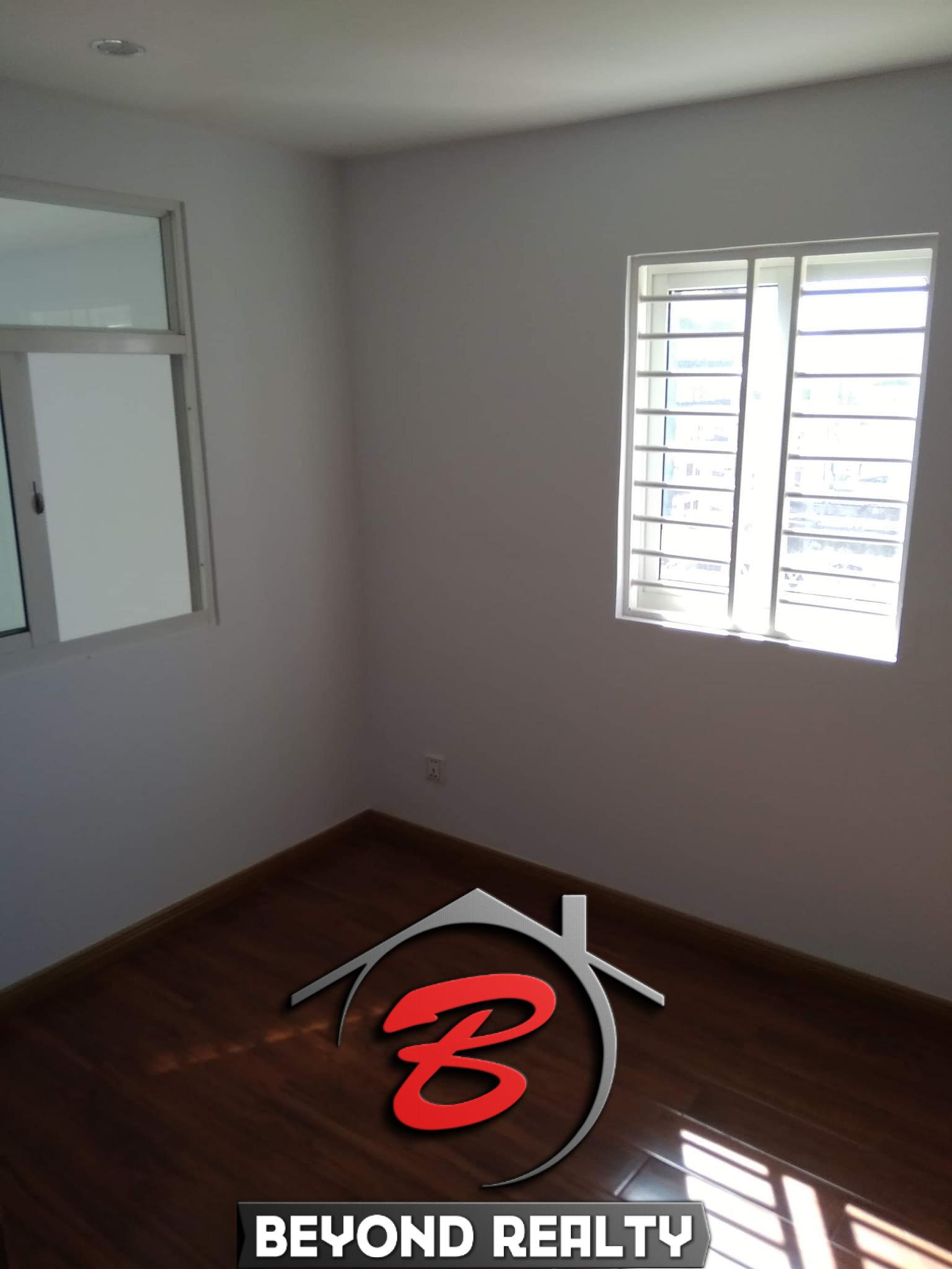 a bedroom of the 2br renovated apartment for sale riverside Phnom Penh