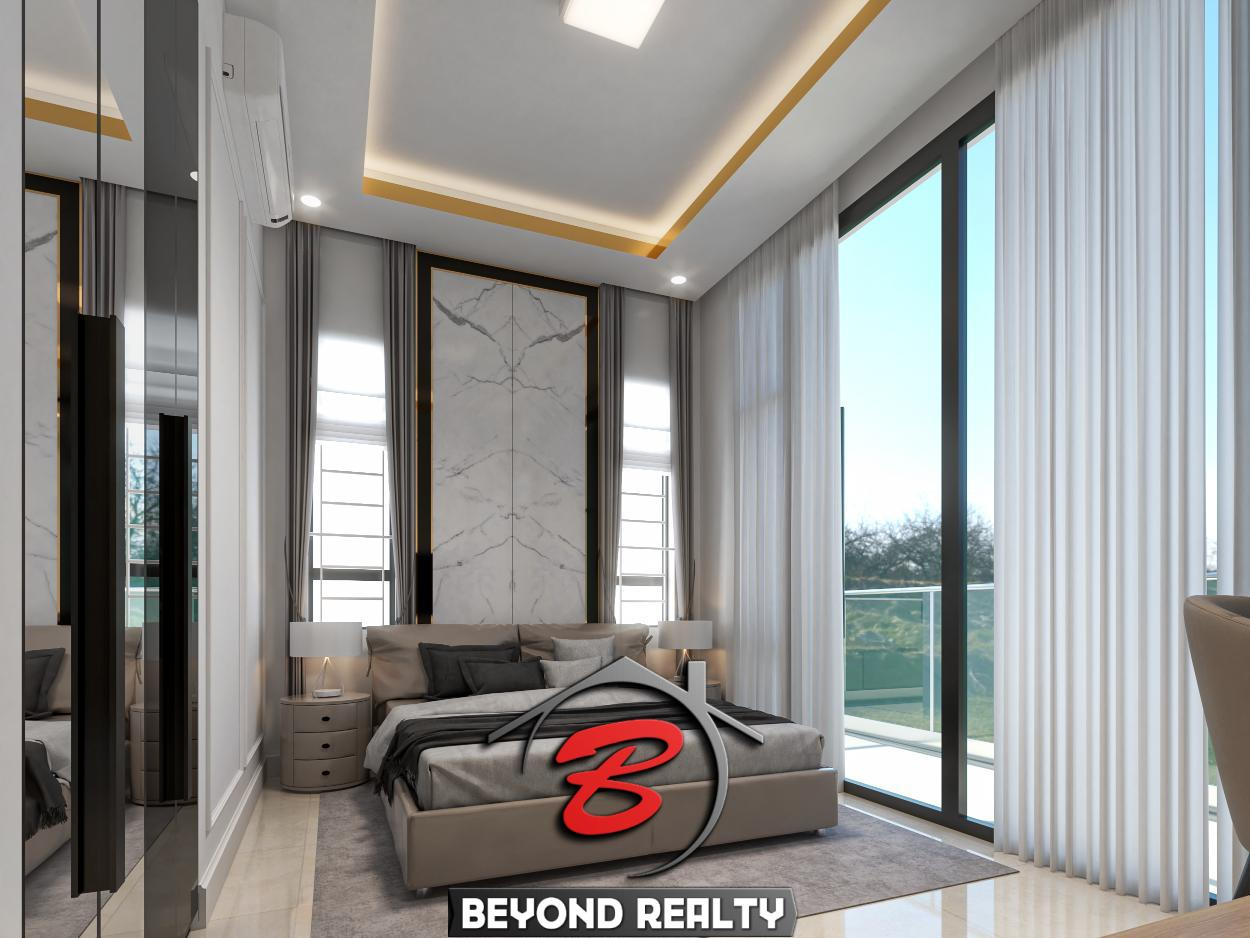 a bedroom of the twin villa for sale in Kampot